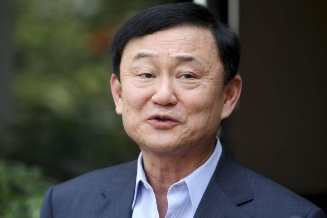 2006年、軍事クーデターで首相の座を追われ、海外生活を続けるタクシン氏