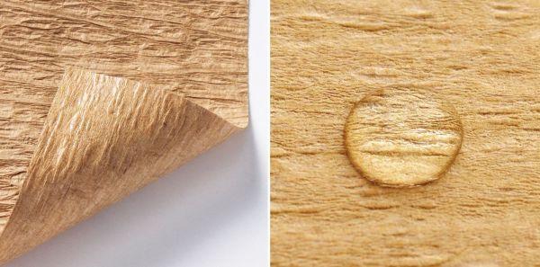 素材は「工業用クレープ紙」。電線や鉄鋼コイルを包装する紙として使用されるなど、高い強度をもった再生紙