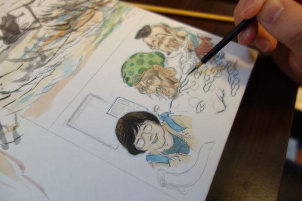 記者の似顔絵を描くRYOさん