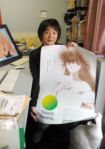 「きまぐれオレンジ★ロード」のポスターを手にするまつもと泉さん=2010年3月16日、川崎市、雨宮徹撮影