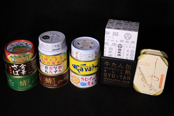 「日本百貨店しょくひんかん」の一角にある缶詰売り場「カンダフル」で購入した缶詰。品ぞろえは多彩だ=2021年4月、長島一浩撮影