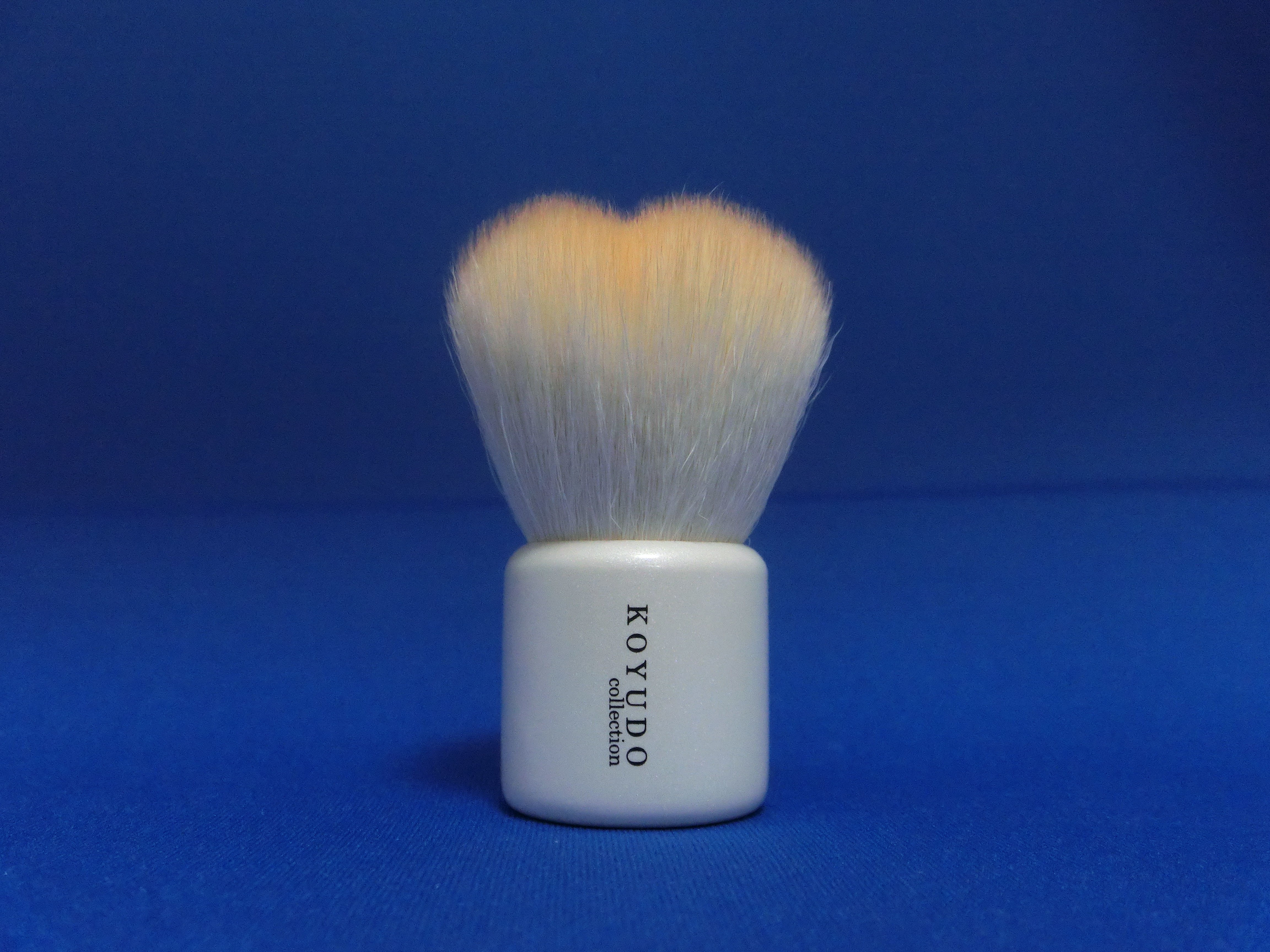 <熊野筆>フラワー型洗顔ブラシ   (橙色毛×白軸)