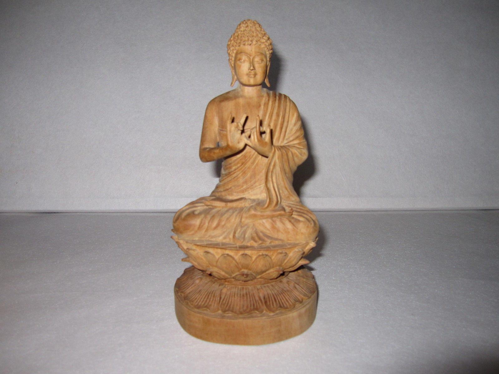 85.仏像(白檀材)            (幅11.5×奥行10.5×高さ12.5cm)