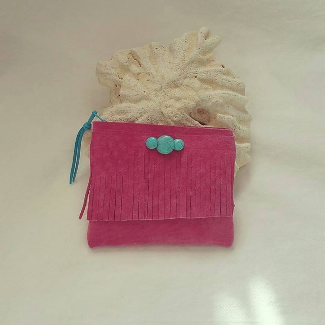 Pink leather mini pouch.