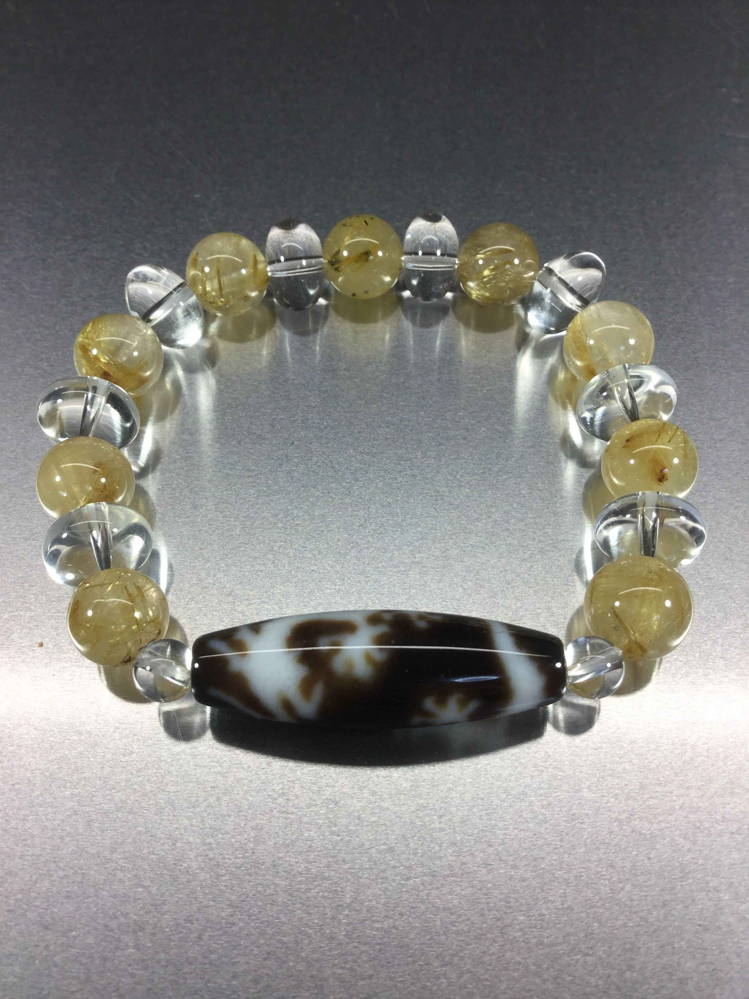 五本爪龍神天珠とゴールドルチルとボタン型水晶のブレスレット