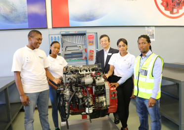 Students of Sedibeng TVET College and President Ohashi of Komatsu