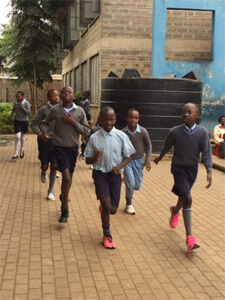 Children jogging in the shoes they received