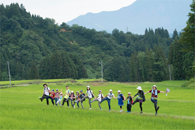 Friendship Camp for Mothers and Children: In a rice field halfway up a mountain