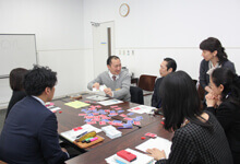 Employees playing the card game