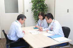 Occupational health staff interviewing employee
