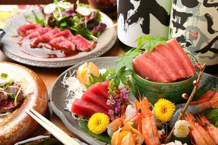 自慢のマグロのお造りや新鮮な海鮮料理