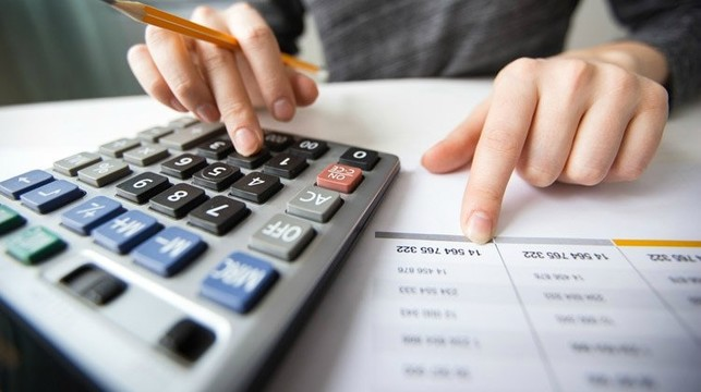 Closeup accountant hands counting on calculator personal finance ss feature