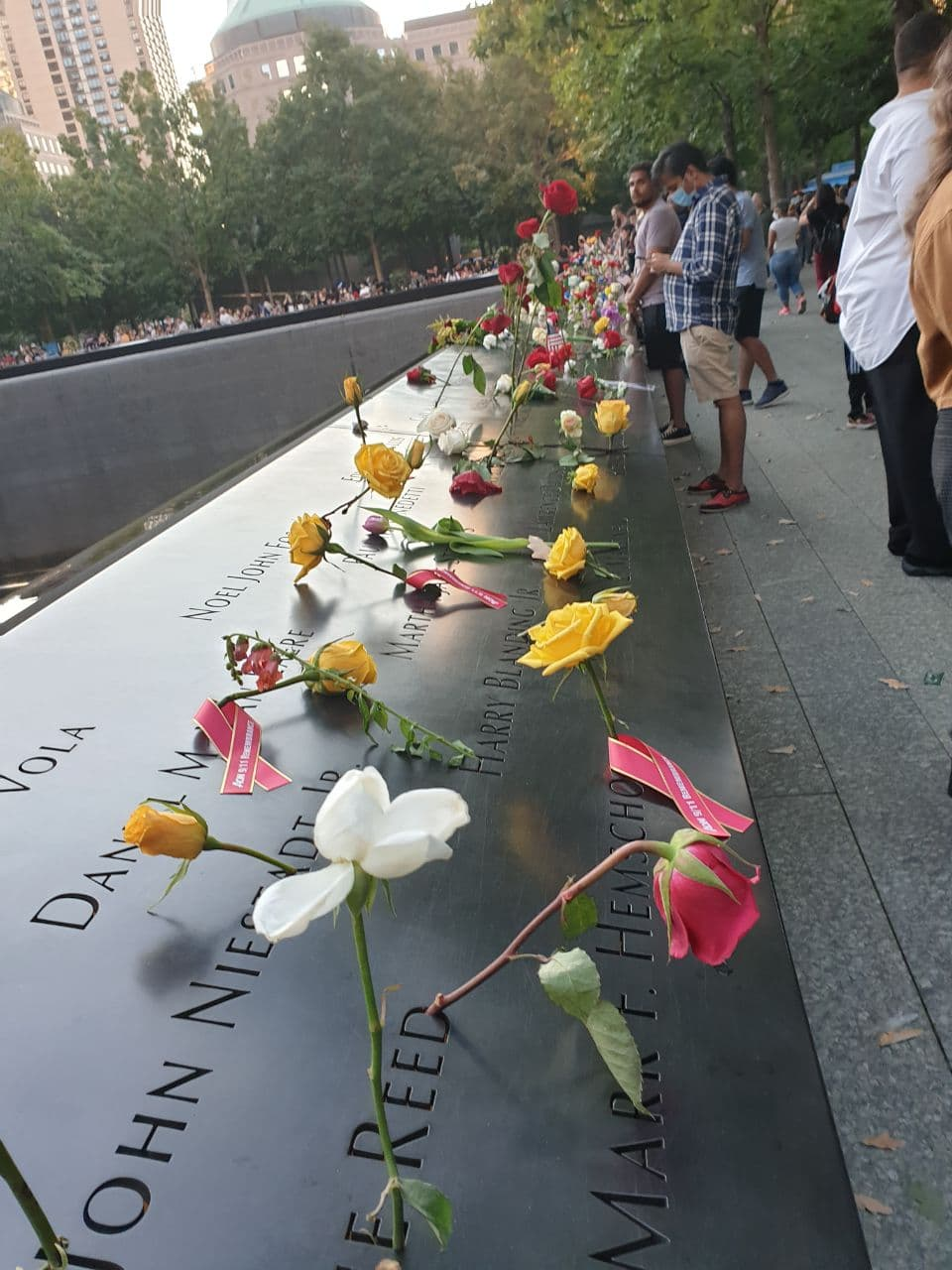 Flowers adorn the memorial of the September 11 attacks on the World Trade Centre on its 20th anniversary
