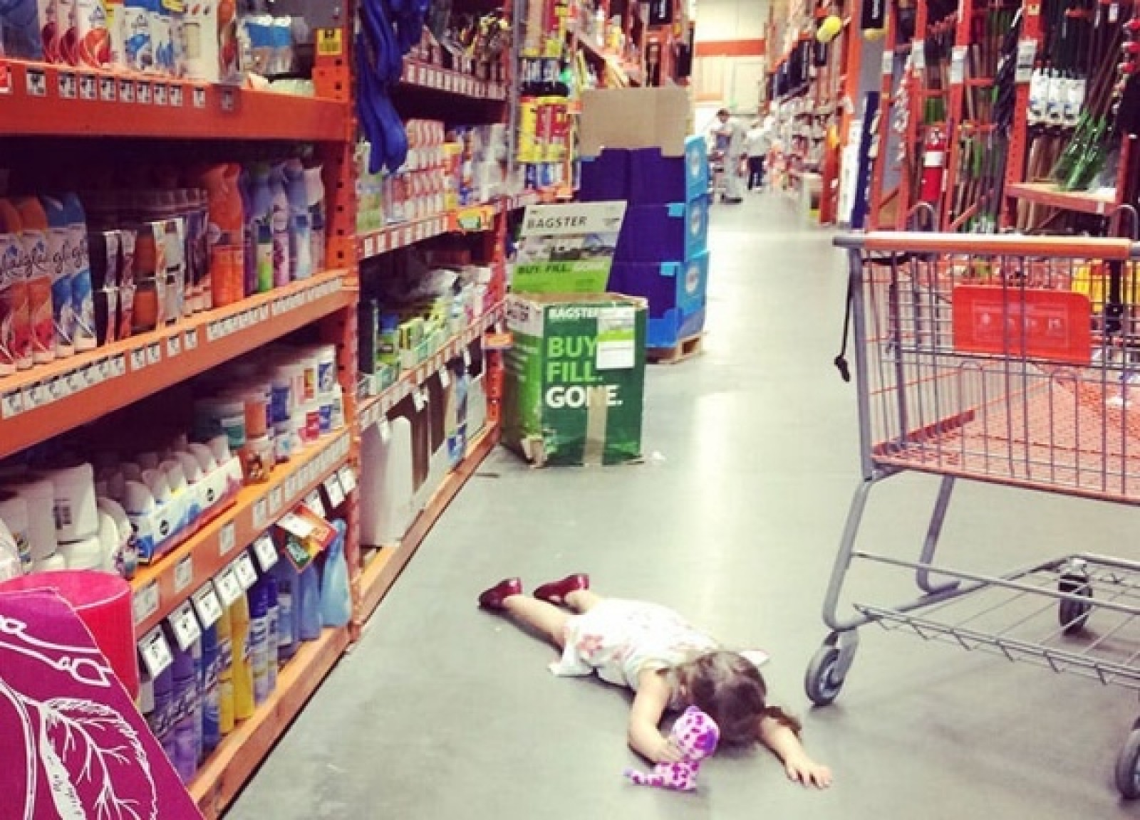 young_girl_laying_on_a_floor_at_a_store.jpg