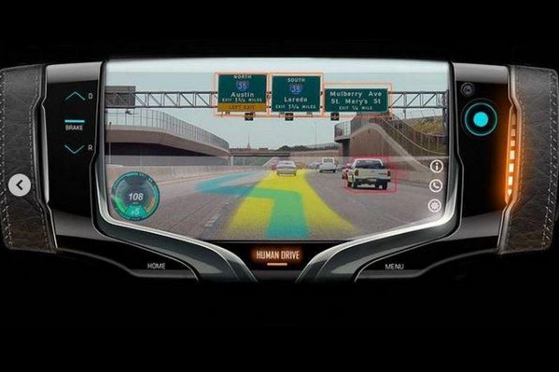 GM Design方向盤概念不僅造型如電玩般具有螢幕,煞車油門控制也在此操作。