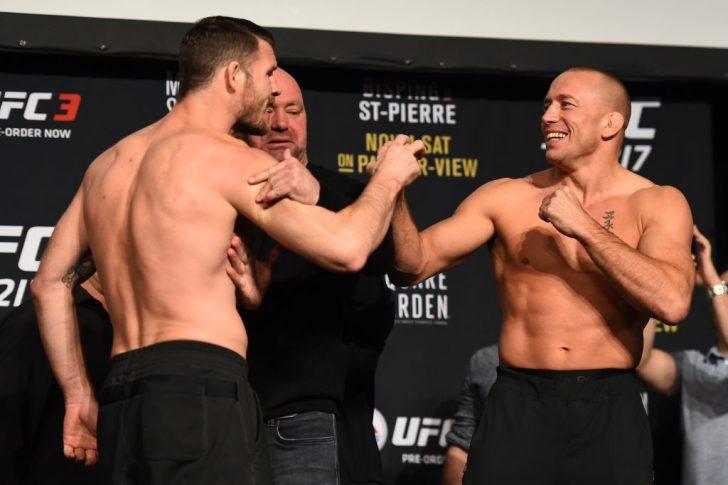 UFC 217:フェイスオフに臨んだマイケル・ビスピンとジョルジュ・サン・ピエール【アメリカ・ニューヨーク州ニューヨーク/2017年11月3日(Photo by Josh Hedges/Zuffa LLC/Zuffa LLC via Getty Images)】