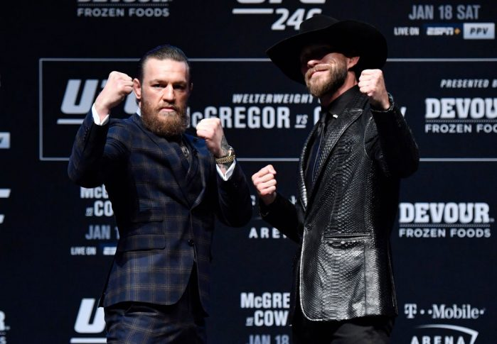 UFC 246:イベント前記者会見でフェイスオフに臨んだコナー・マクレガーとドナルド・セラーニ【アメリカ・ネバダ州ラスベガス/2020年1月15日(Photo by Jeff Bottari/Zuffa LLC via Getty Images)】