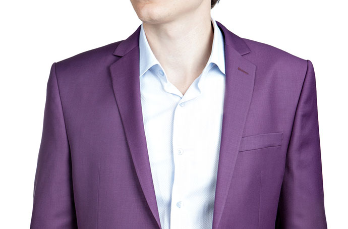 Purple suit of clothes, blazer and trousers for men,  isolated on white.