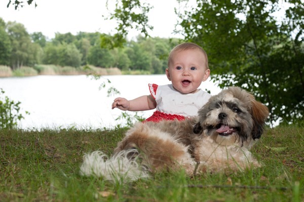 Baby and dog smiling