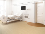 Corner of a hospital ward with a bed, a tv set, a white armchair and curtains on large windows. Beige walls. 3d rendering, Mock up