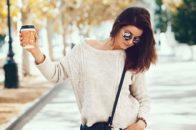 Young-woman-wearing-woolen-sweater-walking
