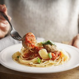 Woman eating meatballs horizontal