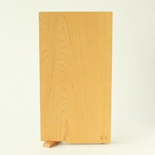 A single plate cutting board with stand L